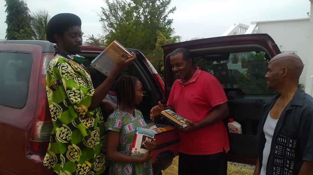 Delivering books to Bro. Jerry's Ancestral Wall for Mbôngi Library/Book Project